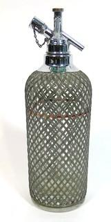 Vintage Art Deco Sparlets Soda Siphon Bottle with Wire Mesh Covering.