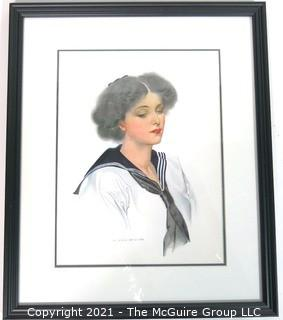 "Framed Under Glass Lithograph of Woman by C. Coles Phillips.  Measures approximately 16"" x 13""."