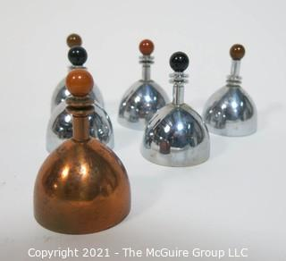 """Set of 6 Mid Century Modern Chrome & Copper Dinner Service Hand Bells with Bakelite Decoration made by Chase. They Measure approximately 2 7/8"""" tall."""
