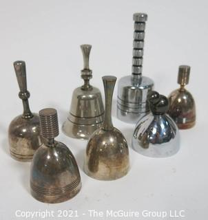 Collection of Seven Dinner Table Bells Including a pair of Christofle Ondulation Bells