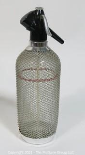 Vintage Art Deco Glass Soda Siphon Bottle with Silver Wire Mesh Covering.
