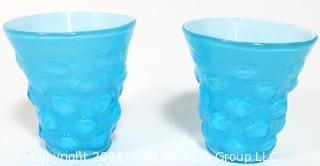 """Pair of Blue Hand Blown Glass Beakers Encased In White Made by the Consolidated Glass Co. Measures approximately 5"""" tall."""