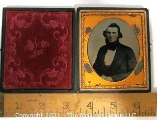 "Antique Daguerreotype Plate Photograph Of A Man in Velvet Lined Hard Case.  Measures approximately 3"" wide."
