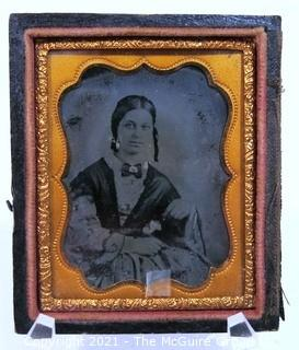 "Antique Daguerreotype Plate Photograph Of A Woman in Velvet Lined Hard Case.  Measures approximately 3"" x 2 1/2""."