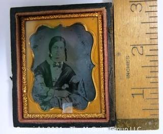"""Antique Daguerreotype Plate Photograph Of A Woman in Velvet Lined Hard Case.  Measures approximately 3"""" x 2 1/2""""."""