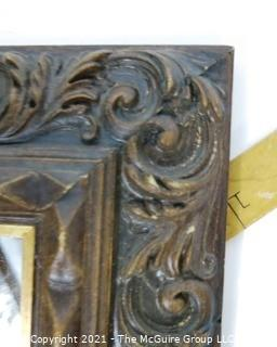 """Wide Carved Wood Framed Wall Mirror.  Measures approximately 19"""" x 16""""."""