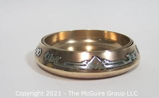 """Three Piece Sterling Silver on Bronze Arts & Craft Period Nesting Trinket Trays Made by Heintz Art Metal for RH Macy Department Stores.  They measure approximately 3 1/2"""" in diameter."""