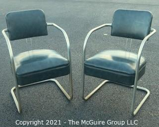 Pair of Vintage Mid Century Modern Chrome with Green Vinyl Chairs.