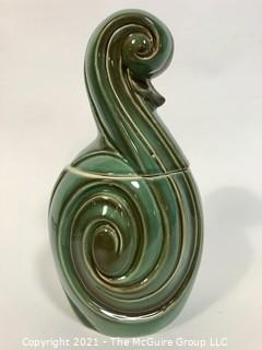"Vintage Mid Century Modern Flourish Shaped Pottery Cookie Jar or Canister.  It measures approximately 12"" tall."