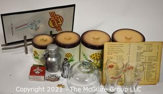 Collection including vintage diner menus, Coca Cola, Aluminum Karo Syrup container, and glass cloche and nesting set of canisters
