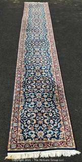 "Hand Woven & Knotted Runner on Blue Ground.  Measures approximately 2'4"" x 18'8""."