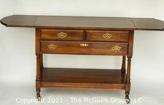 """Cherry Buffet by Statton Trutype Americana with Two Drop Leaf Edges above Three Drawers with Lower Exposed Shelf on Castors. 68""""W when open and 33""""T"""