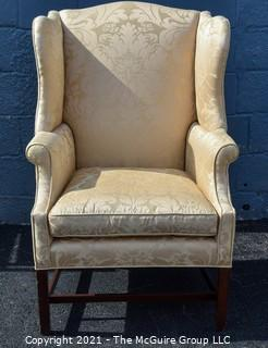 Yellow Damask Upholstered Wing Back Chair. {Note: repaired leg}