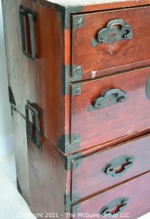 Asian Tansu Chest on Chest with Bronze Hardware.  Some damage to drawers and back.  WE HAVE NO MEASUREMENTS FOR THIS