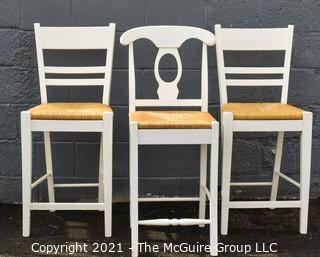 Set of Three White Lacquer and Rush Seat Bar Stools.