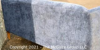 Blue Plush Upholstered Sofa.