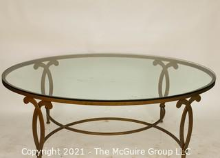 """Oval Heavy Gilt Cast Iron Coffee Table with Glass Insert.  Measures approximately 49""""long x 34"""" wide"""