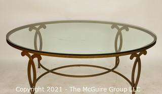 "Oval Heavy Gilt Cast Iron Coffee Table with Glass Insert.  Measures approximately 49""long x 34"" wide"