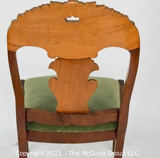 Carved Walnut Side Chair with Green Velvet Seat.