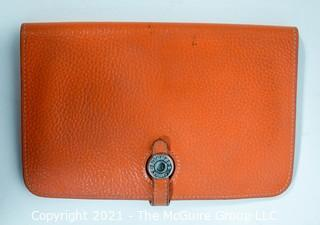 Authentic Hermes Togo Dogon Duo Wallet in Orange Abricot.