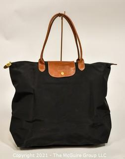 Longchamp Le Pliage Foldable Large Tote Bag with Leather Handles and Flap.