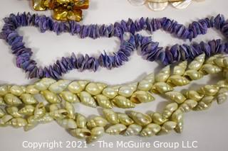 Four Shell and Mother of Pearl Beaded Necklaces.
