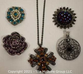 Five Rhinestone Brooches or Pendants.