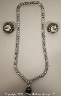 Clear Rhinestone with Faux Pearl Necklace and Coordinating Rhinestone Clip On Earrings.