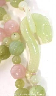 "Pink Quartz & Green Stone or Jade Beads with Carved Seahorse Catch Necklace.   Measures approximately 32"" long."