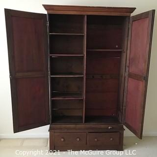 """Two piece armoire with original hardware. (Note the repurposed stenciled wood). 45 1/2"""" W x 20""""D x 81""""T"""