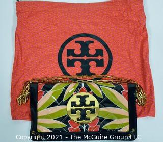 """Tory Burch Floral Print Patent Leather Folding Clutch with Chain Strap & Navy Blue Interior.  Measures approximately 12""""L x 1""""W x 7""""H. Comes with its original Tory Burch cloth storage bag."""
