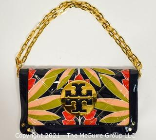 "Tory Burch Floral Print Patent Leather Folding Clutch with Chain Strap & Navy Blue Interior.  Measures approximately 12""L x 1""W x 7""H. Comes with its original Tory Burch cloth storage bag."