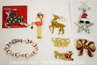 Collection of Christmas Jewelry Including Rhinestone Brooches.