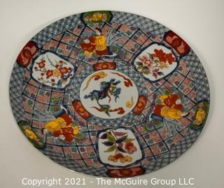 "Porcelain Asian Stamped Hand Painted Charger or Plate. Measures approximately 16"" in diameter."