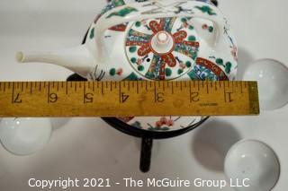 Porcelain Asian Stamped Hand Painted Tea Pot and 5 Tea Cups.