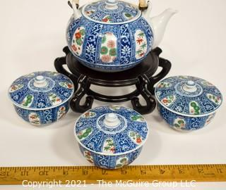 Porcelain Asian Stamped Hand Painted Tea Pot and 3 Tea Cups with Lids.