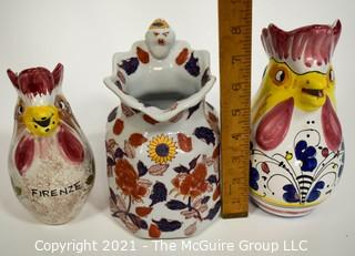 Three water pitchers: Italian rooster (hand painted Deruta; oriental motif; and Italian rooster (Nordstrom)