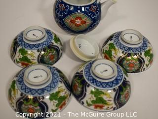 Porcelain Asian Stamped Hand Painted Tea Pot and 4 Tea Cups.