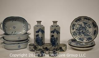 Porcelain Pottery Asian Stamped Hand Painted Blue & White Bowls, Plates and Sake Set.