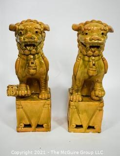 "Pair of Heavy O.A.I. Oriental Arts Hong Kong Yellow Glazed Ironstone Foo Dogs; Some wear; Approximately 18.5"" tall."