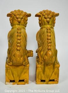 """Pair of Heavy O.A.I. Oriental Arts Hong Kong Yellow Glazed Ironstone Foo Dogs; Some wear; Approximately 18.5"""" tall."""