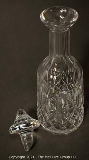 "Waterford Crystal decanter with stopper; 12"" tall.  (Note: damage to base of stopper)"