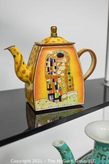 Collection of Asian Porcelain and Small Hand Painted Tea Pots.