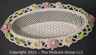 "Belleek Lily Blossoms Basket, Annual Basket 2007, Numbered. Measures approximately 10"" long."