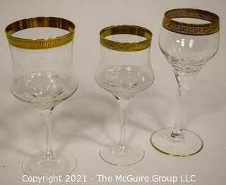 """Assorted Crystal Stemware with Gold Rim: <br> <br> (5) 7 1/2""""T stems <br> (6) 7 1/2""""T stems <br> (8) 6 7/8""""T stems"""