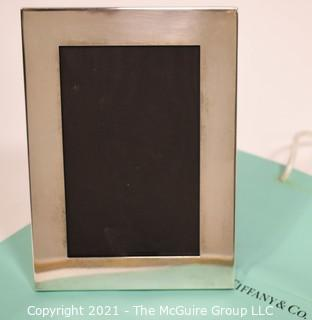 "Tiffany & Co. Sterling Silver Picture Frame.  Measures approximately 5"" x 7""."