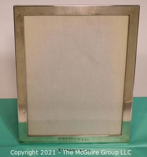 "Tiffany & Co. Sterling Silver Picture Frame.  Measures approximately 8"" x 10""."