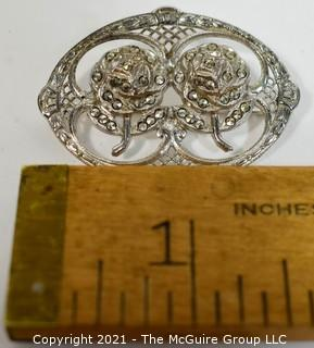 Sterling Silver Filigree with Marcasite Brooch.   Measures approximately 1 1/2' long.