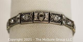 Antique Diamond Platinum over 14K Gold Art Deco Bracelet with Safety Catch.  Center Stone Missing.  Weighs approximately 15.8g