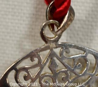 """Pierced Sterling Silver Pendant on Red Cord Necklace.  Measures approximately 2"""" in diameter and 11.2 g weight."""